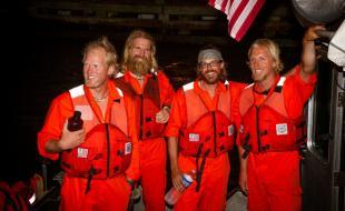 Adam Kreek, Markus Pukonen, Pat Fleming and Jordan Hanssen celebrate their rescue.