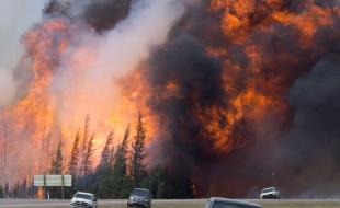 A giant fireball is seen as a wildfire rips through the forest 16 kilometres south of Fort McMurray, Alberta on May 7, 2016. (THE CANADIAN PRESS/Jonathan Hayward)