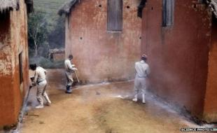 Workers can use insecticide to try to stop outbreaks of the plague. [Photo via BBC Science Library]
