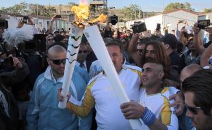 Ibrahim Al-Hussein, a refugee of the war in Syria, carried the Olympic Torch in Athens. (Getty Images/Milos Bicanski)