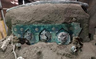 A view of a chariot that was found in Civita Giuliana, north of Pompeii. (Parco Archeologico di Pompei/The Associated Press)